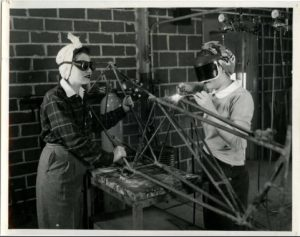 two_cadettes_welding_parts_of_the_tail_of_a_wrecked_plane_1943_28944572512_o