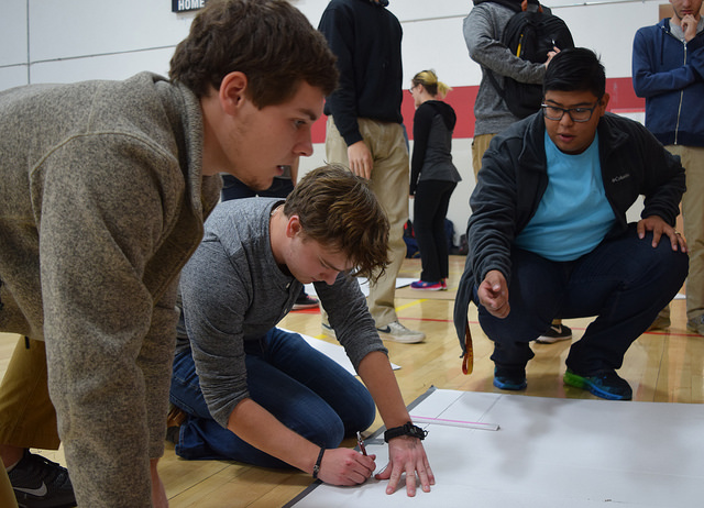 Students designing a boat for the 2016 Mechanical Engineering Learning Team boat race competition