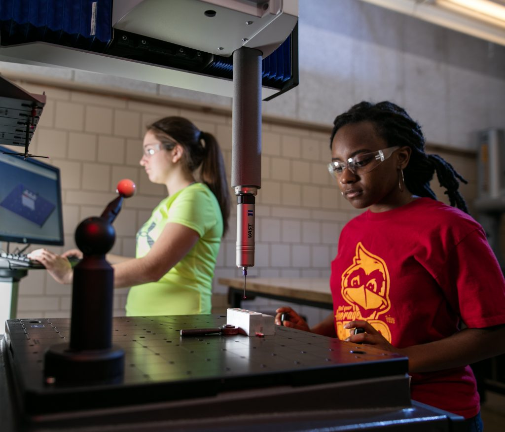 A student uses the coordinate measuring machine in the metrology lab.